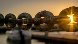 A steel chain by a dock.