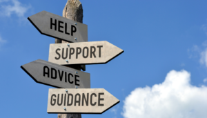 Different signs with the words, help support advice, and guidance.