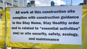 Construction fence with text on it.