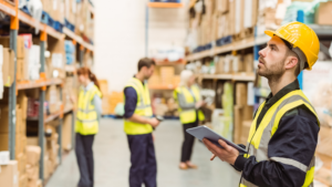 Employees reviewing losses in a warehouse.